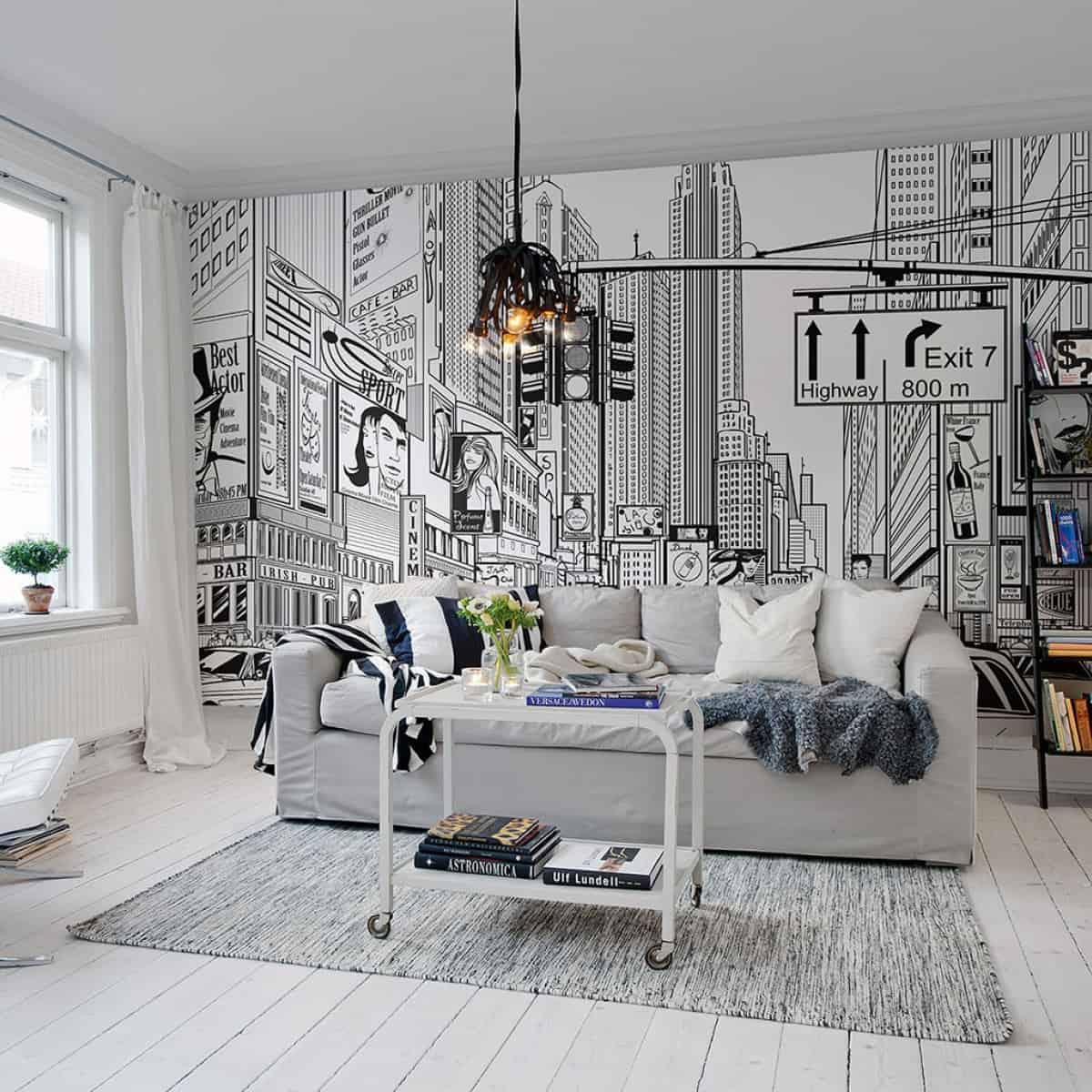 camera cu parchet alb, cafeteria alba, canapea gri și un perete cu fototapet benzi desenate
